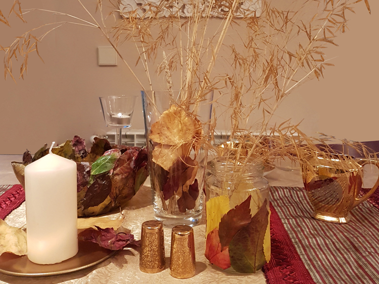 Thanksgiving table decor with fall leaves