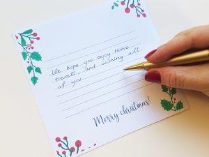 escribiendo felicitacion navidad