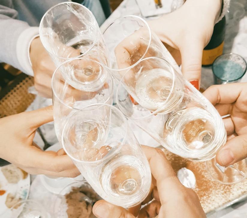 Friendsgiving celebration champagne glasses toast
