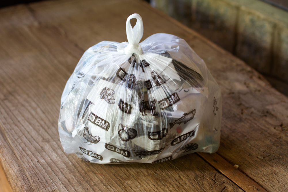 plastic bag full of paper for halloween pumpkin