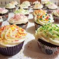 Chocolate cupcakes decorated with buttercream frosting and different color sprinkles